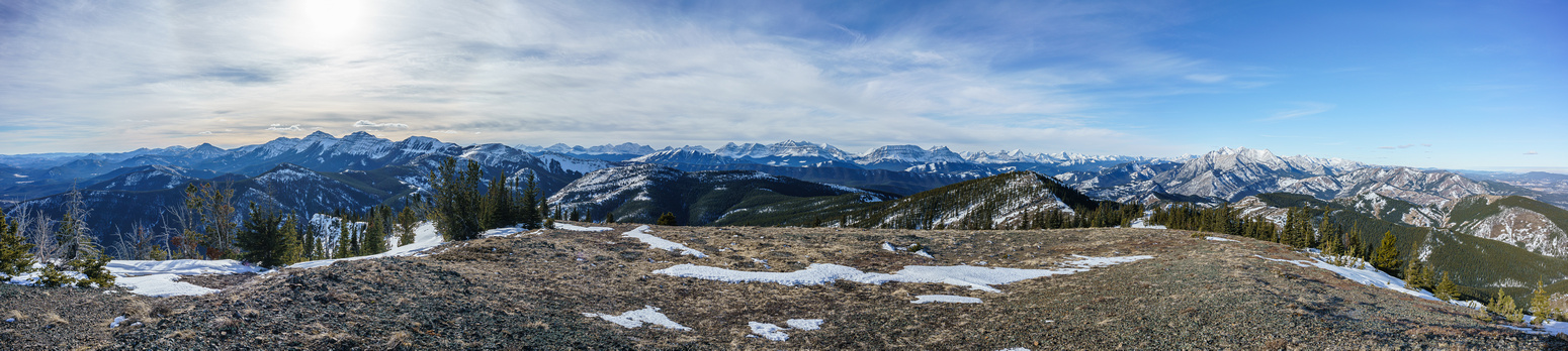 Pano looking south (L), west (C) and north (R). Burke at left, the High Rock Range at center and the Highwood Range at right.