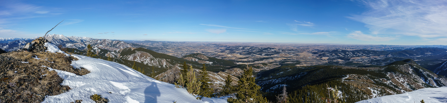 Looking north (L) past the summit cairn towards Holy Cross and Bull Creek Hills and east (C) over the prairies towards Calgary.