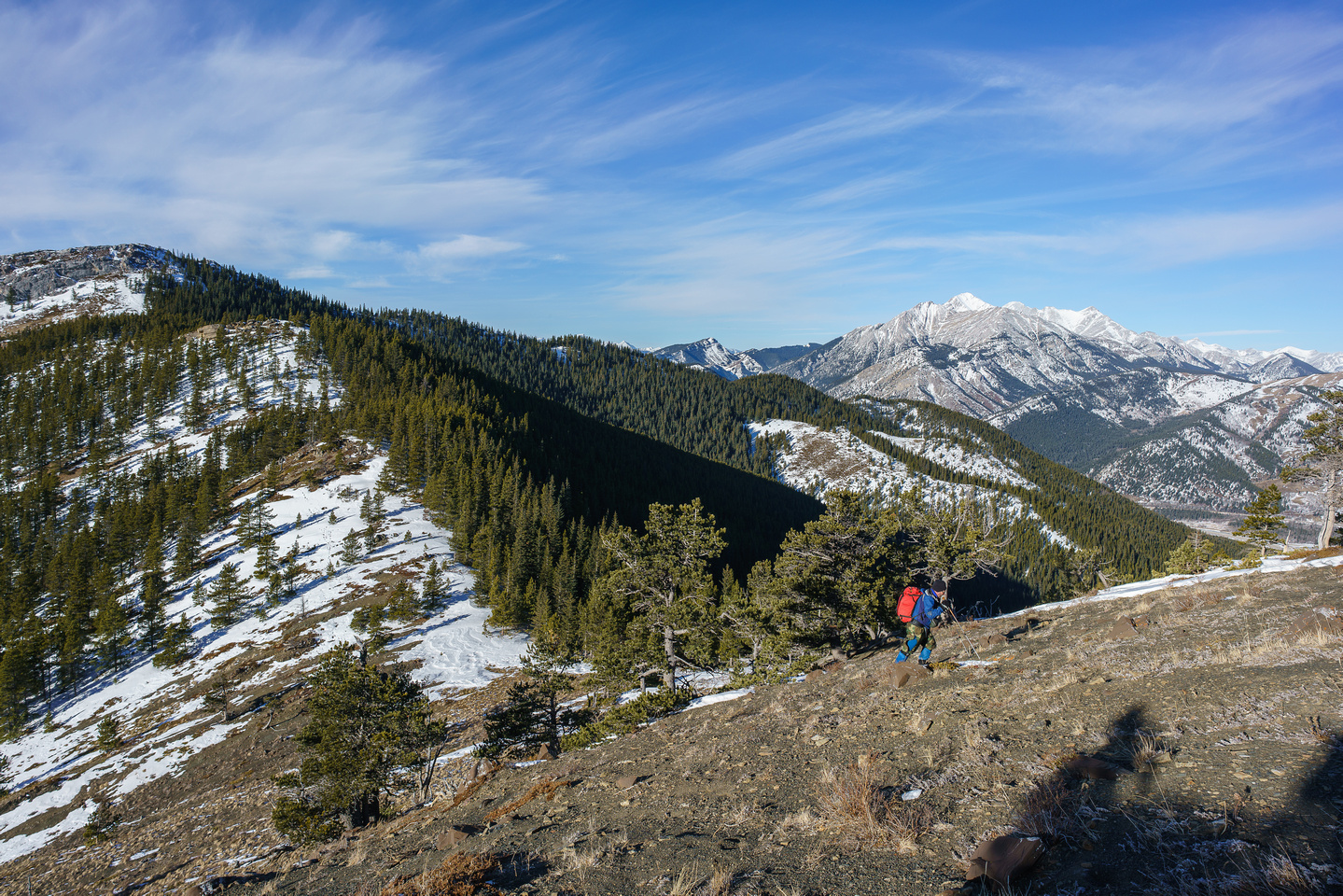 Dave grunts up to Miller Creek Ridge with North Limestone Ridge at left and Holy Cross at distant center.