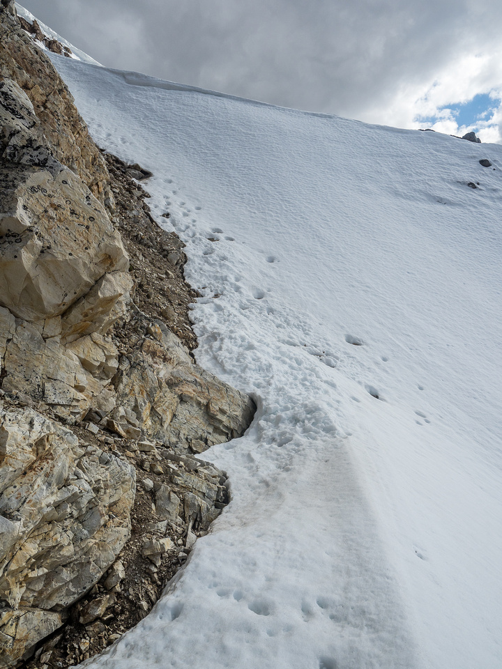 Looking up the shallow couloir to its exit above.
