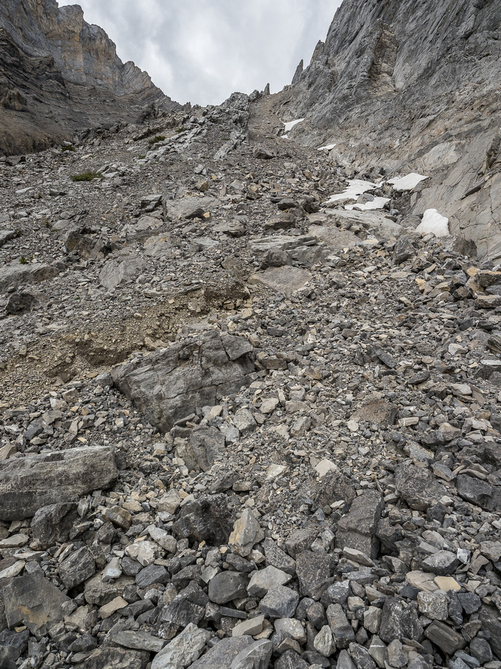 The scree gully slowly curves up to the right.