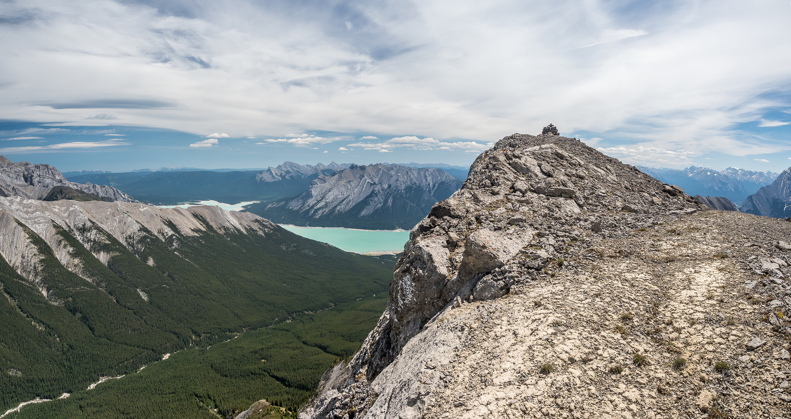 The summit of Stelfox with Whitegoat Creek at lower left and Mount Michener and Abraham Lake in the distance.