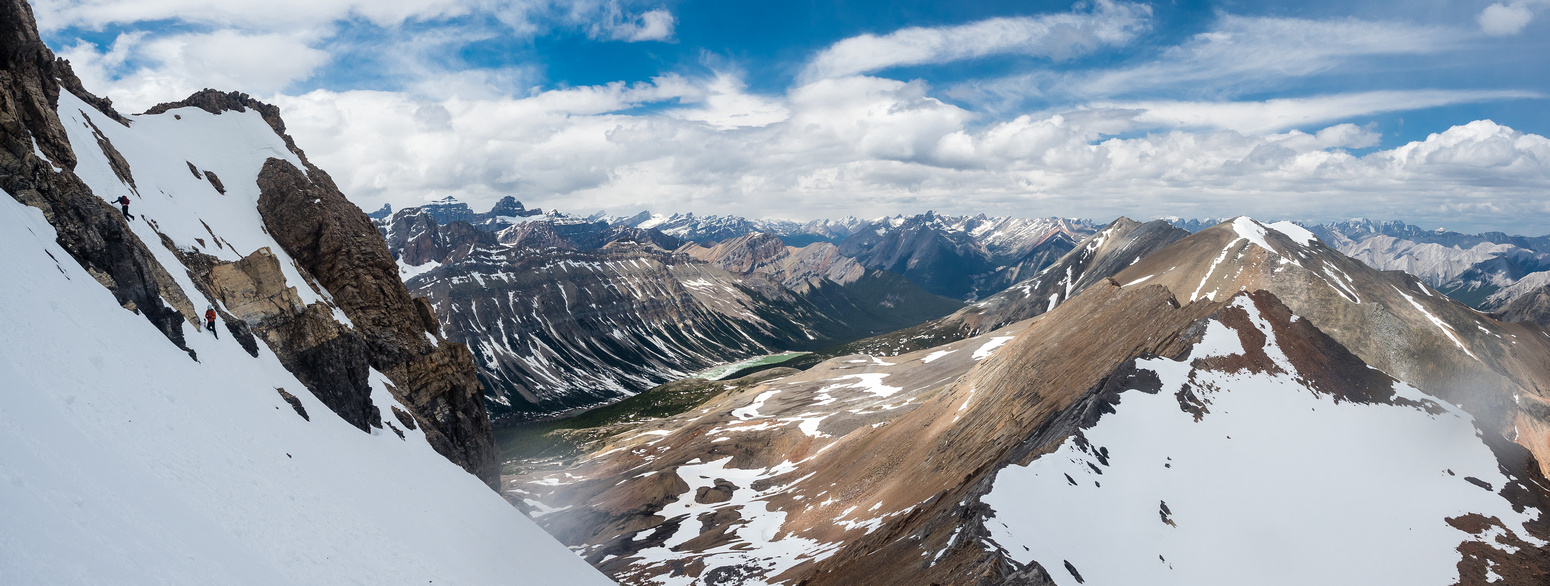 I love this shot of Robin and Phil downclimbing the steep snow with Landslide Lake and Peak in the background.