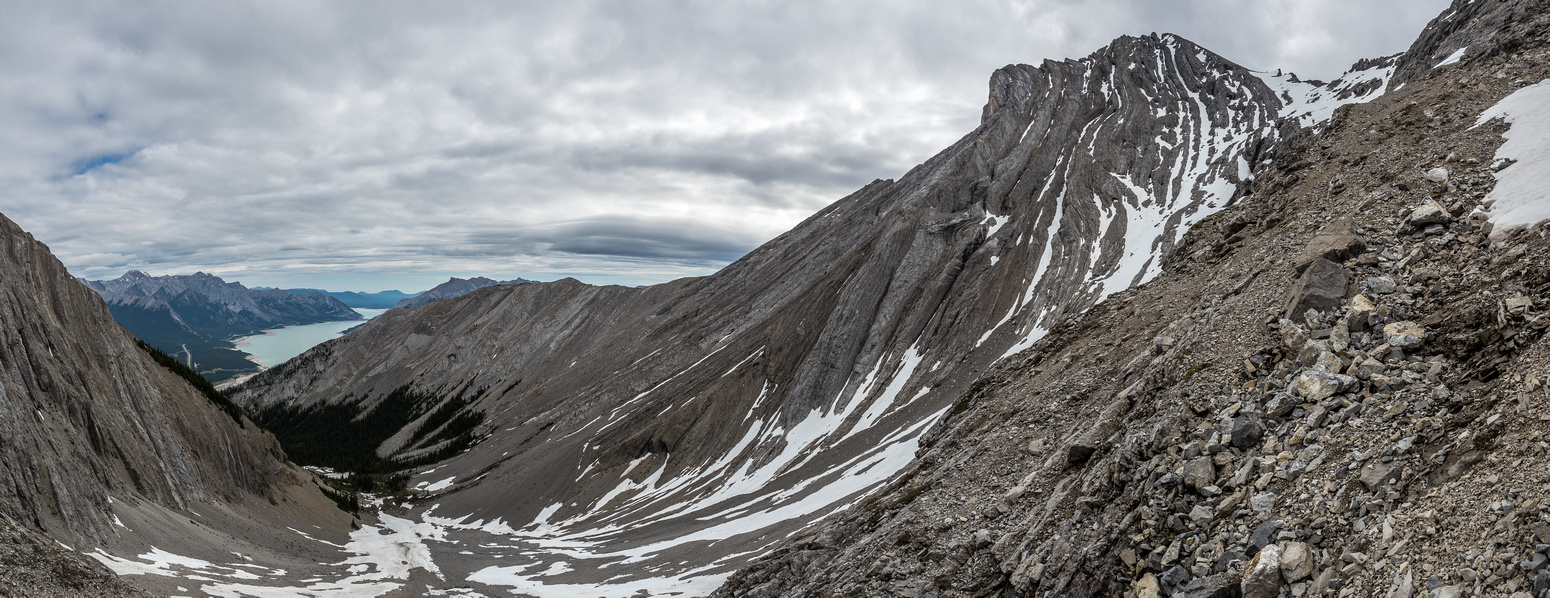 Finally back on scree and heading down to the bowl at left.