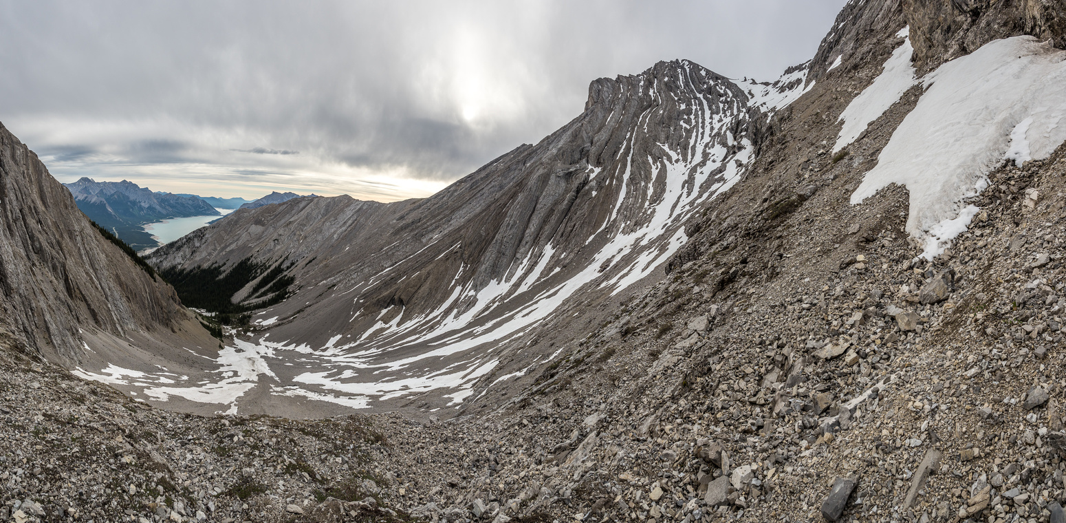 An extremely foreshortened and deceptively easy-looking view along the scree / snow ramp to the summit of Elliott Peak.