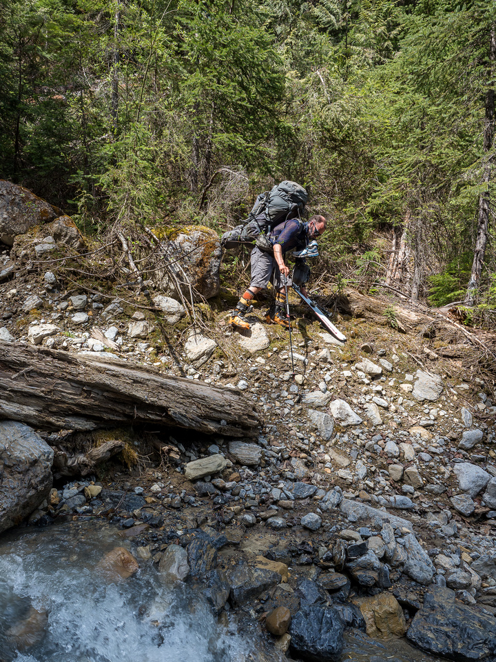 Tricky terrain into a deep gully with a nice cool stream.