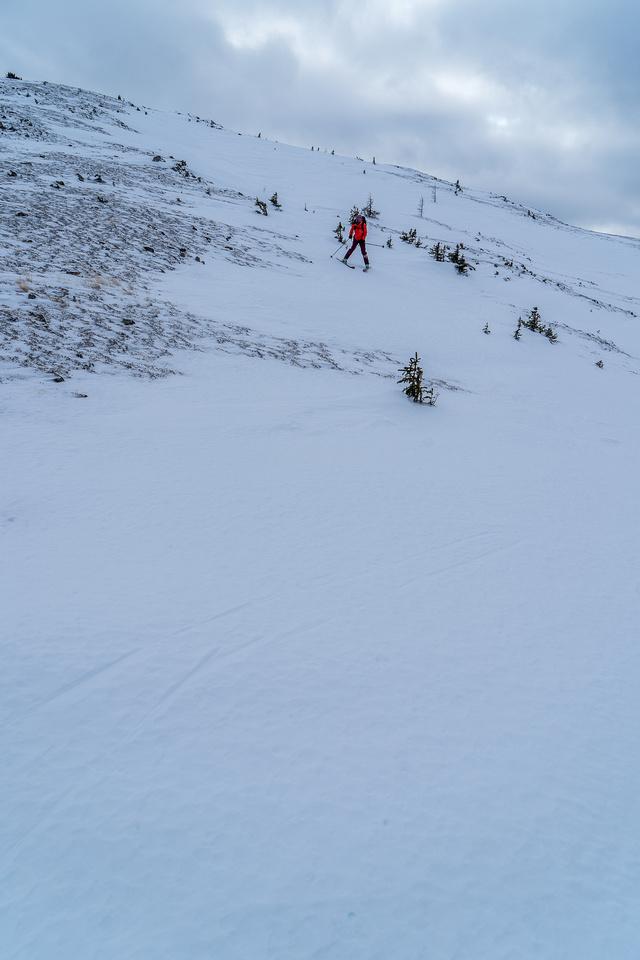 Alison skis down the slabby Quartz Ridge.