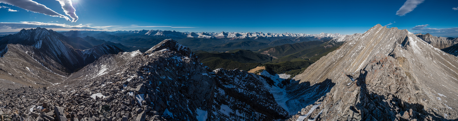 A panorama from the summit looking south (L), west (C) and north (R).