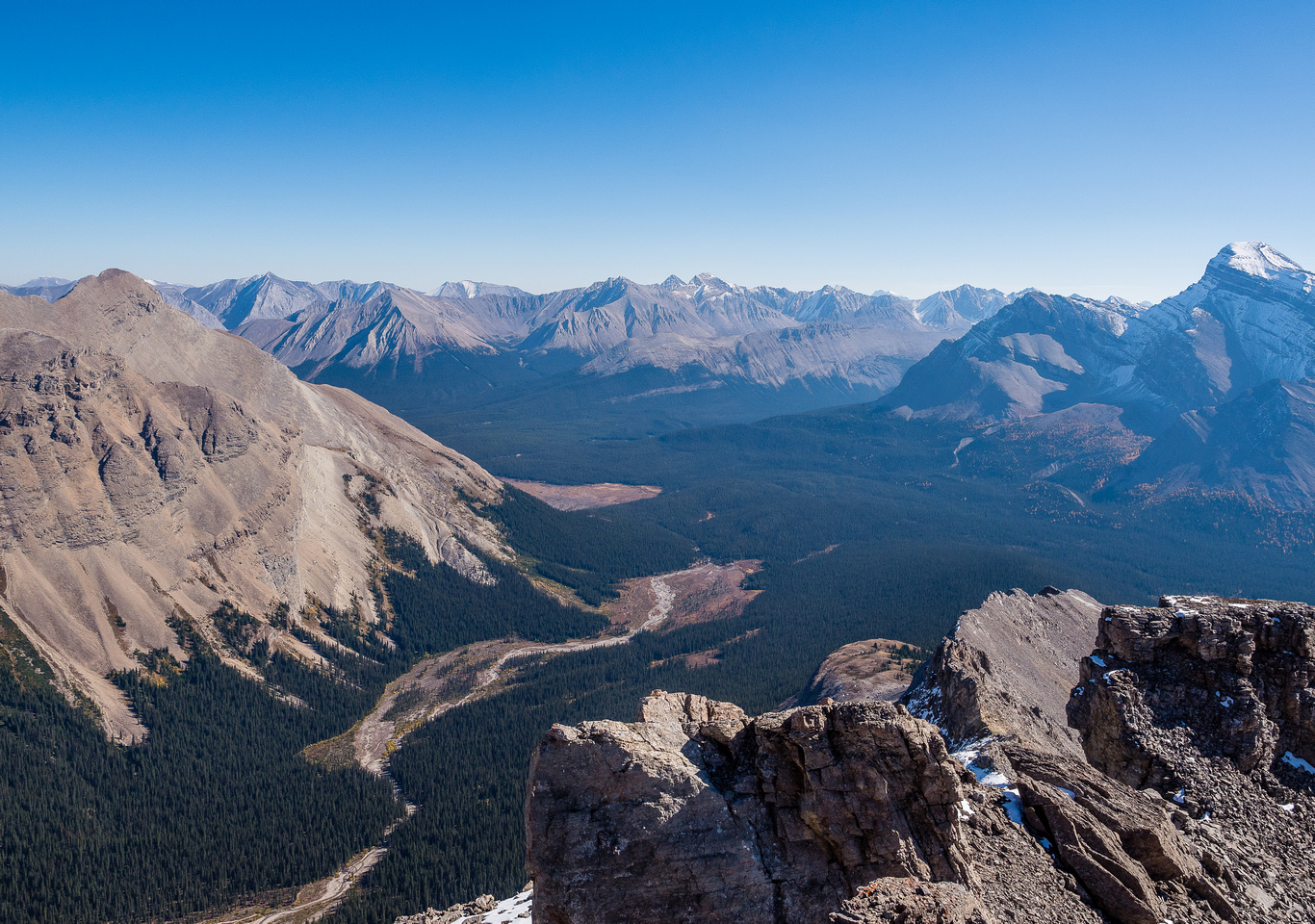 Looking past Mount Douglas (R) towards the Sawback Range and distant peaks such as Gable and Barrier in the Ya Ha Tinda region of the front ranges.