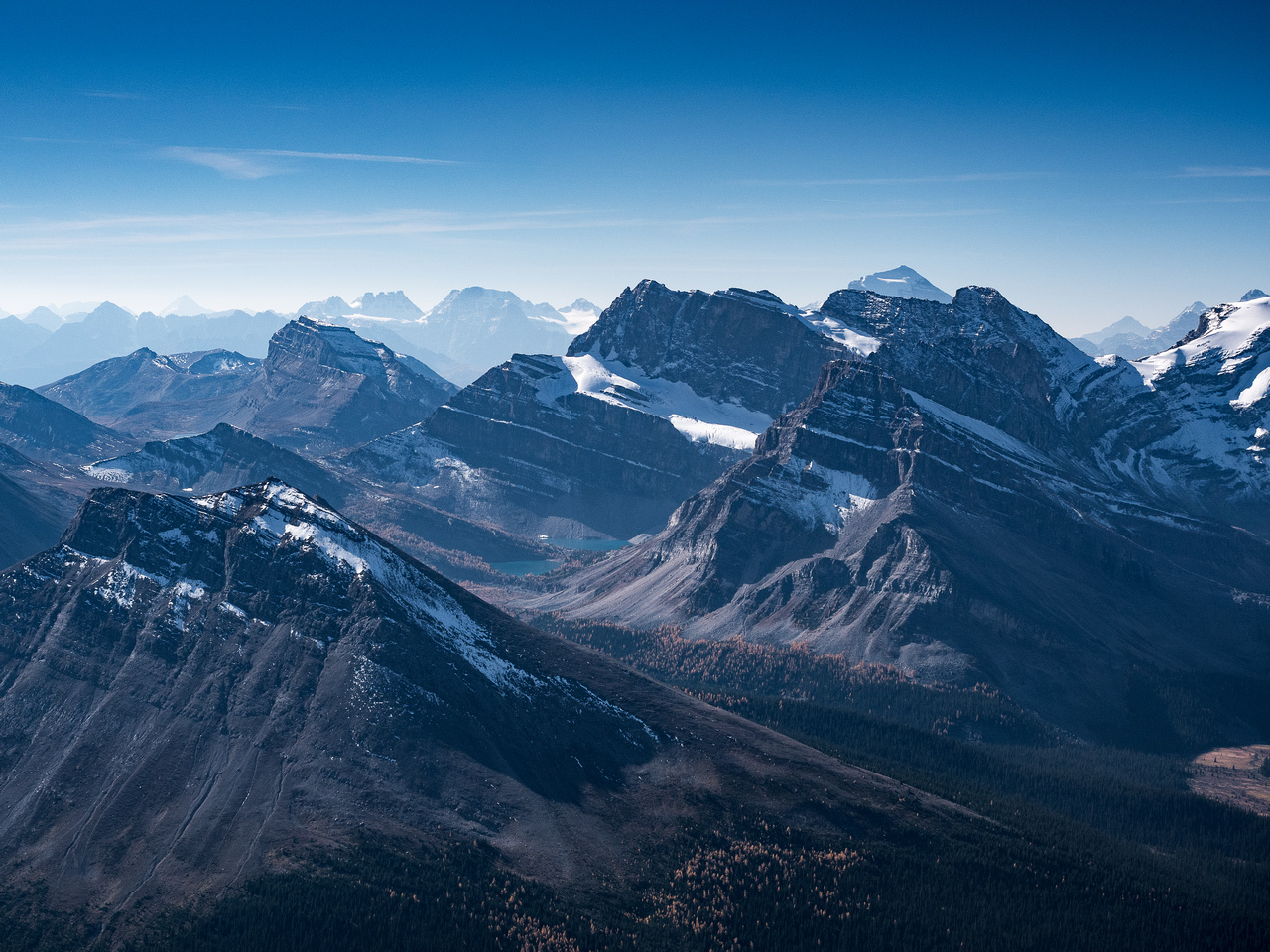 Looking over the Skoki Lakes towards familiar Lake Louise peaks such as Bident and Quadra at left and Temple