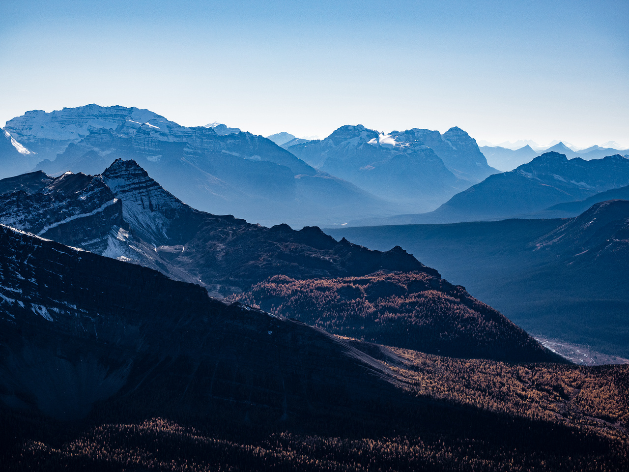 Looking far to the west towards Mount Victoria (L), Cathedral Mountain (C) and Mount Stephen.