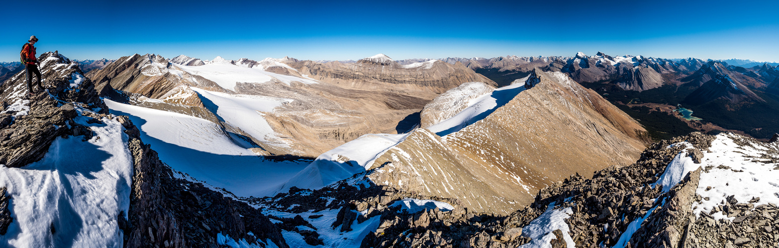 Phil on the summit of Cyclone Mountain with views over the Drummond Glacier at left, Mount Drummond at center right and Pipestone at right