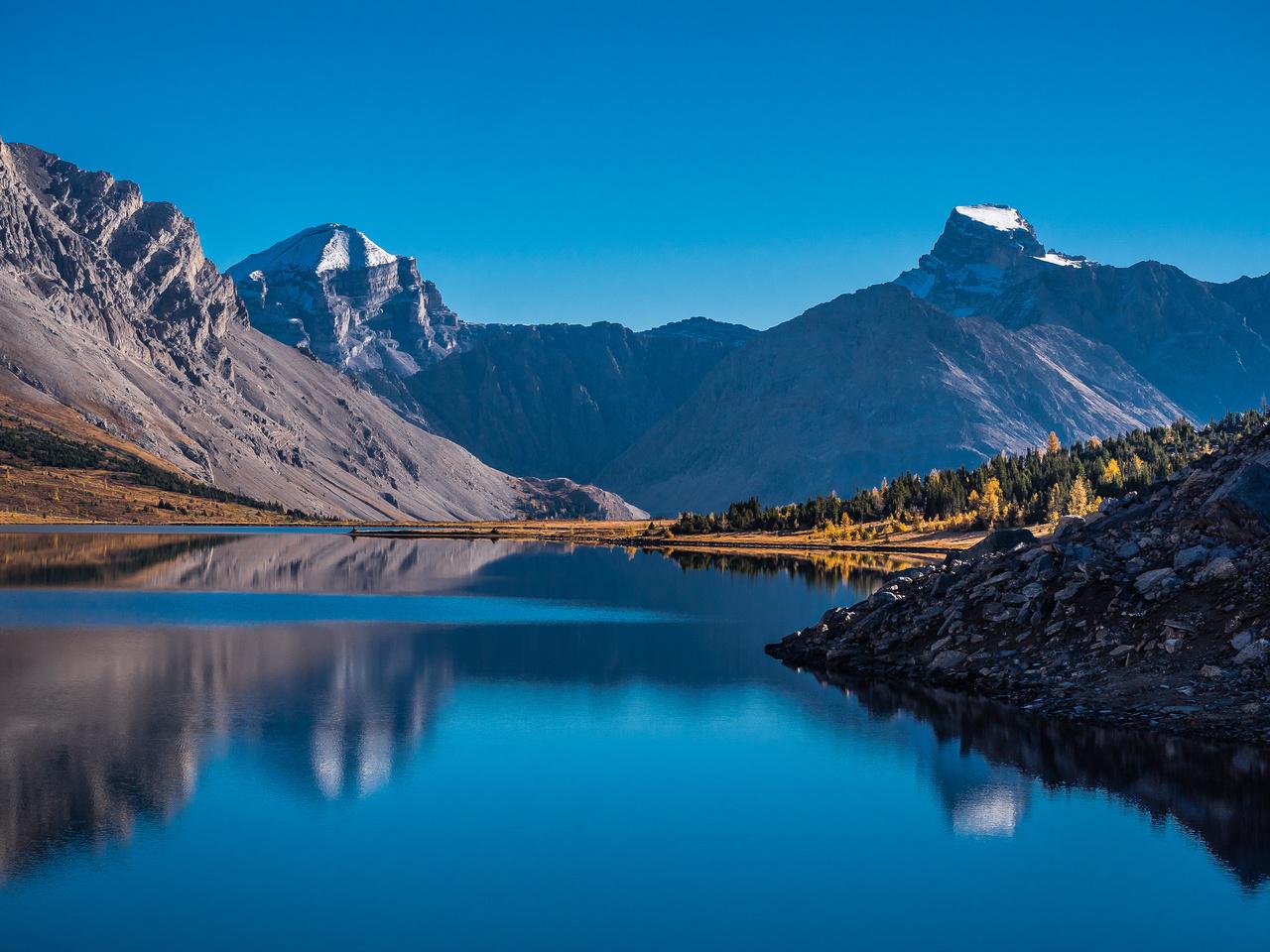Mount Douglas and St. Bride reflect in Ptarmigan Lake.