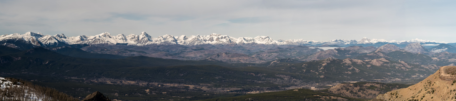 A panorama looking west and north to the Flathead Range includes Darrah just left of center and Coulthard to the right of that.