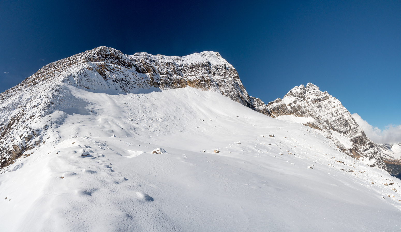 The east face appears slick and snow covered at left with the summit at center and Odaray at right.