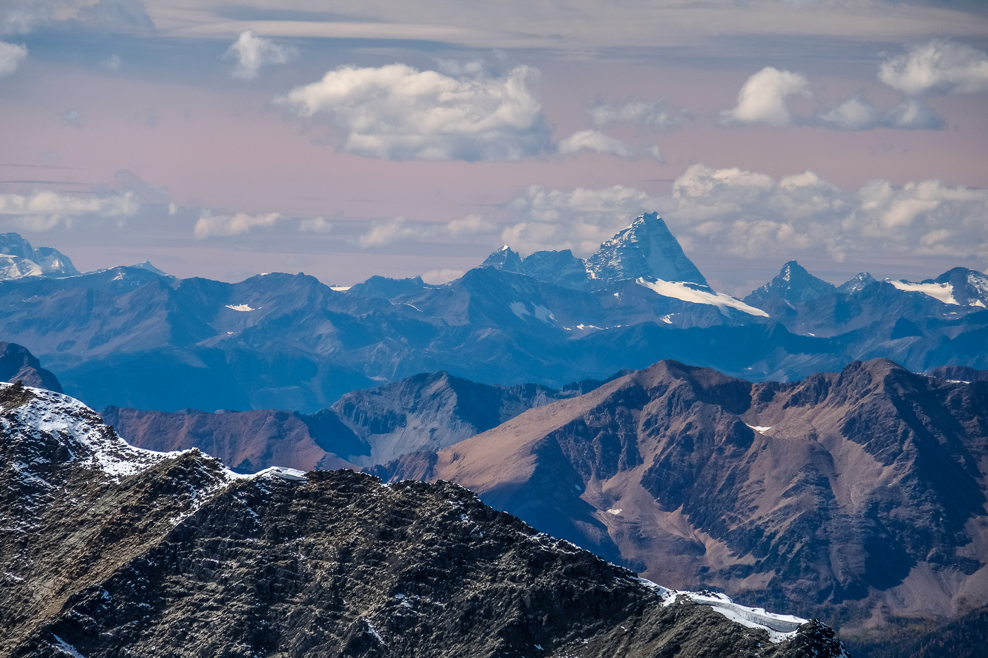 The unmistakable form of Mount Sir Donald looming far to the west in the Purcell Mountain Range.