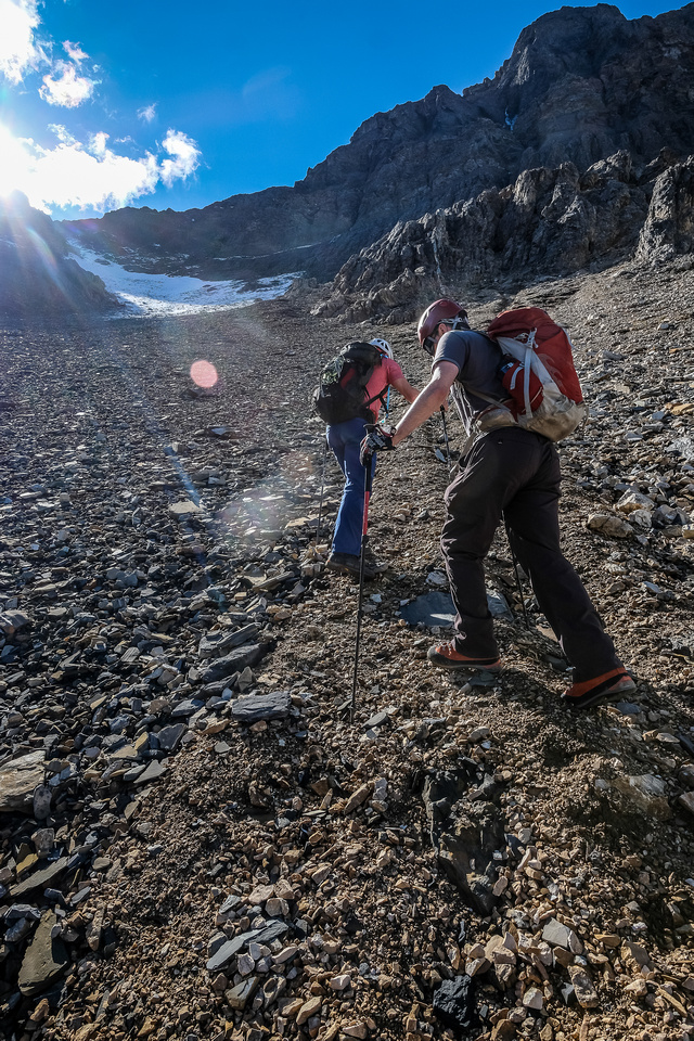 Anton and Mike start the long grunt up talus towards Biddle Pass high to the left here.