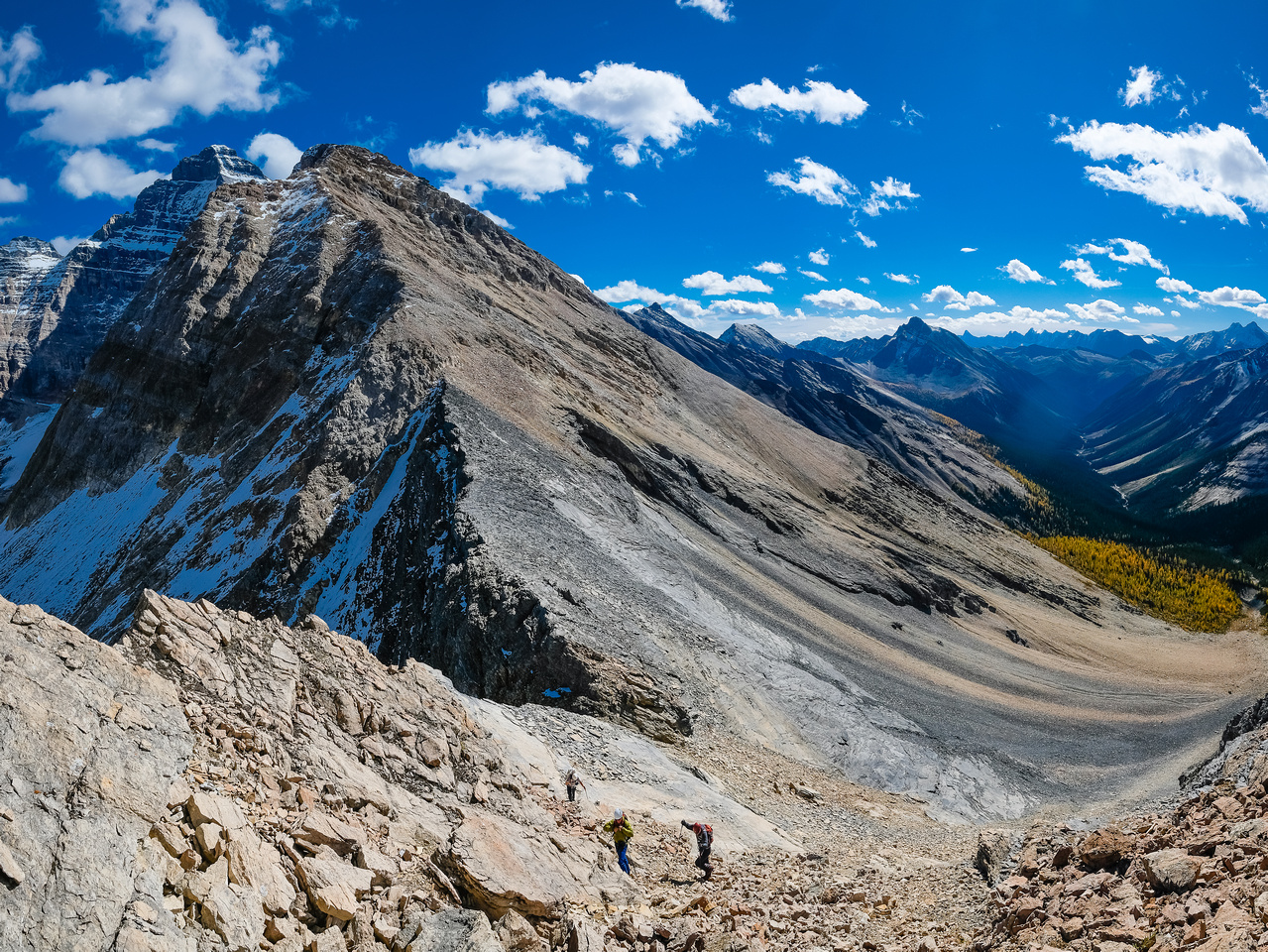 Note the grey rock behind the guys that we traversed from Biddle Pass, Biddle rising at upper left.