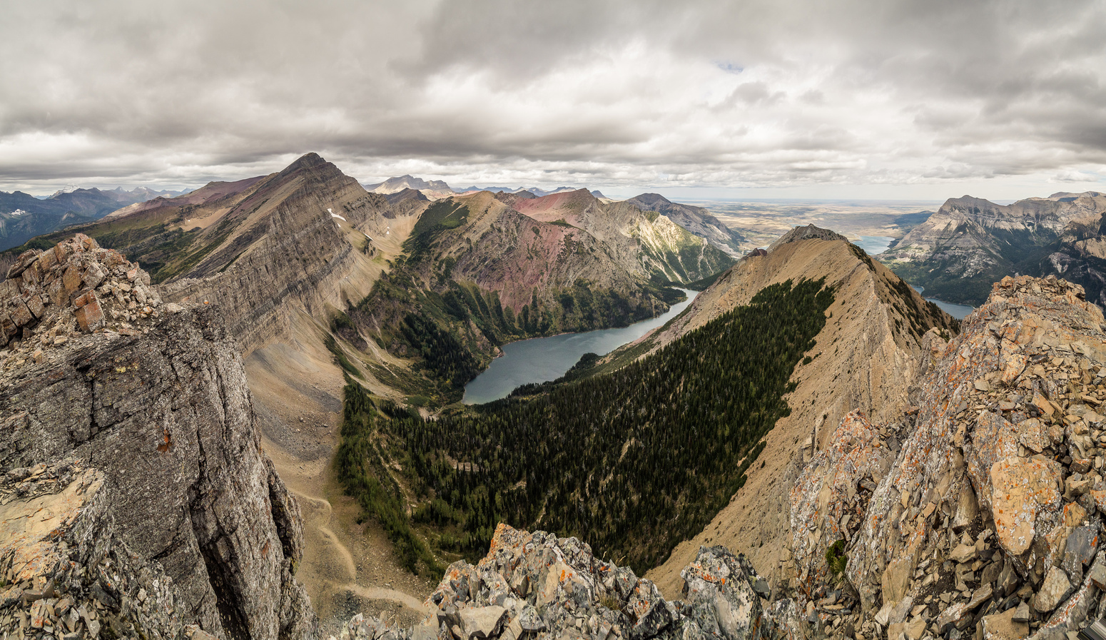 Looking down at Bertha Lake from the summit. Alderson at left and the north ridge stretching out in front of me here. Bertha Peak rises left of the lake.
