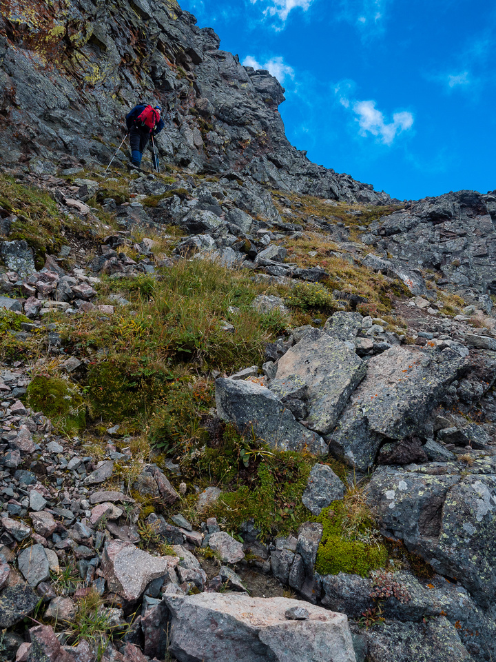 The scrambling is never difficult if you keep traversing under the summit.