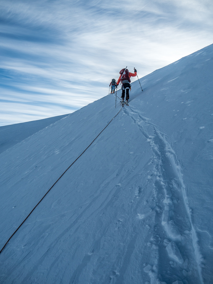 """The slope steepened near the """"ramp"""" which led over a slightly open crevasse to the upper bowl just under the RR col."""
