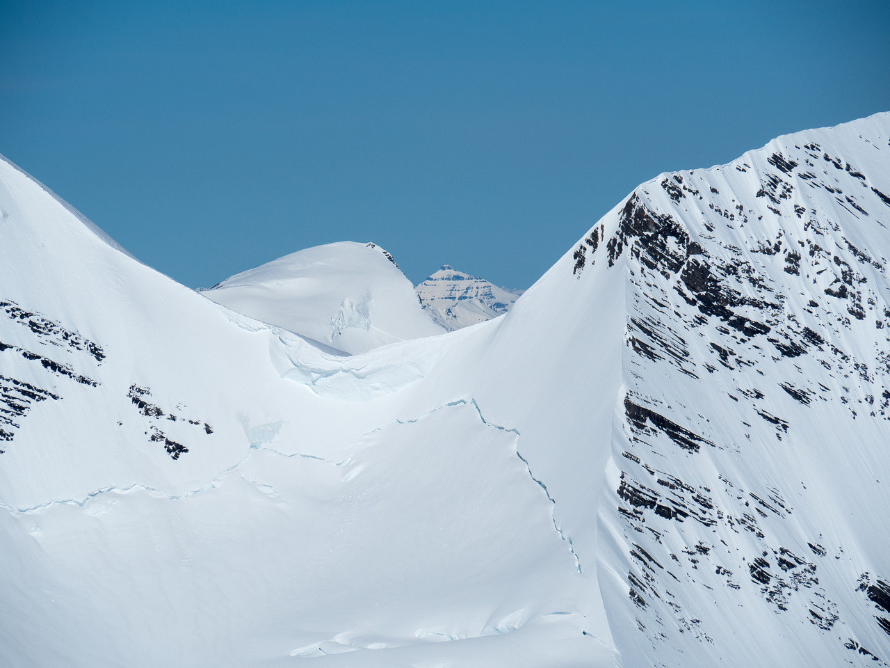"""Mount Phillips (named after """"Donald 'Curly' Phillips"""") shows up through the Robson / Helmet col."""
