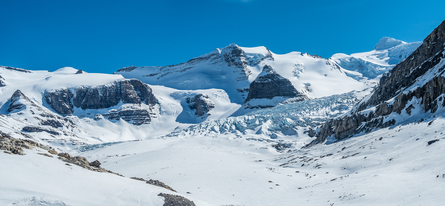 A last look back at the Robson Glacier and Resplendent (upper right). Extinguisher Tower at center.