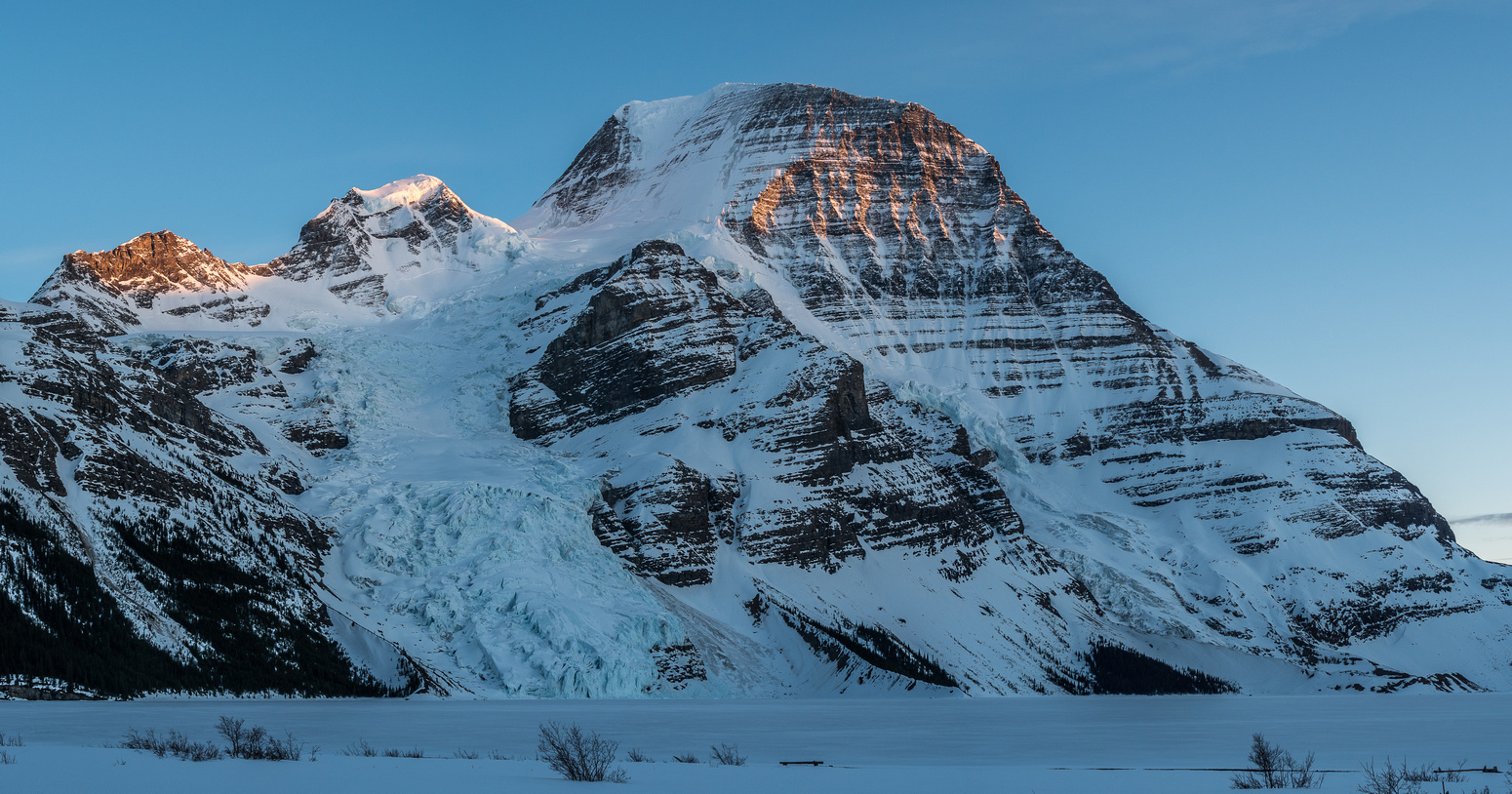 Dying light on Waffl, The Helmet and Robson from the Berg Lake shore.