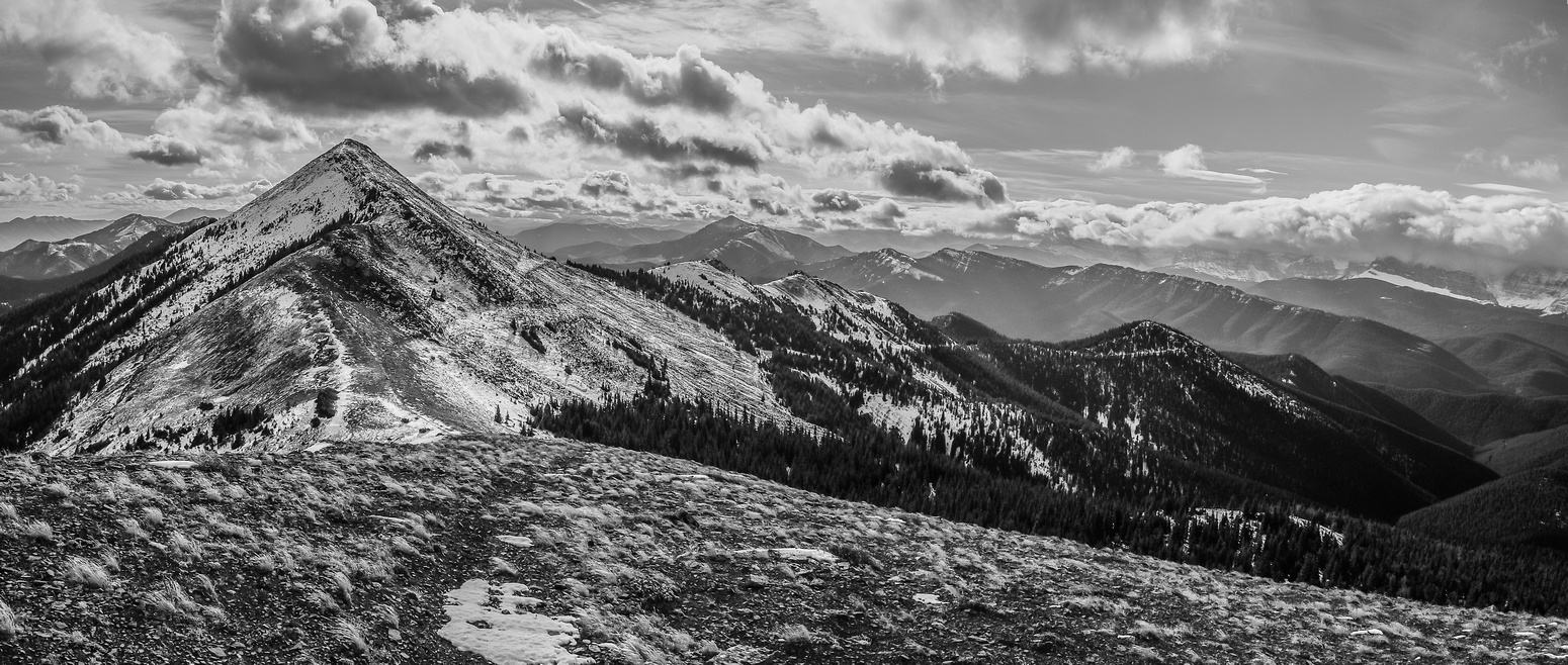 Looking back at the south summit, our access ridge stretches out to the west (right). Sugarloaf lookout in the distant background.
