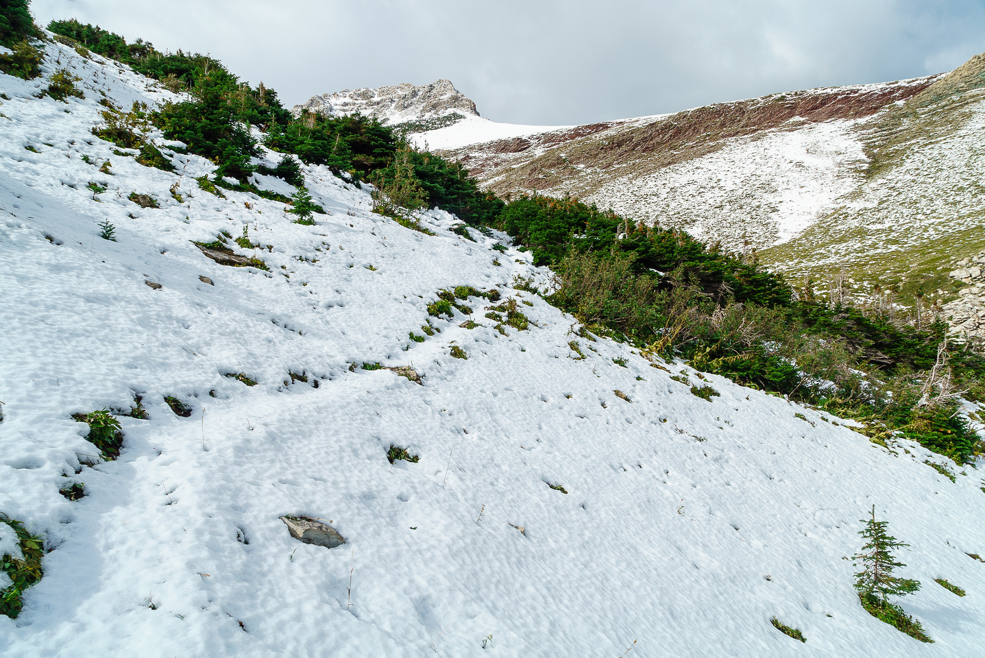 Following the faint trail for a wee bit further - Nugara's route is plastered in snow above me here.