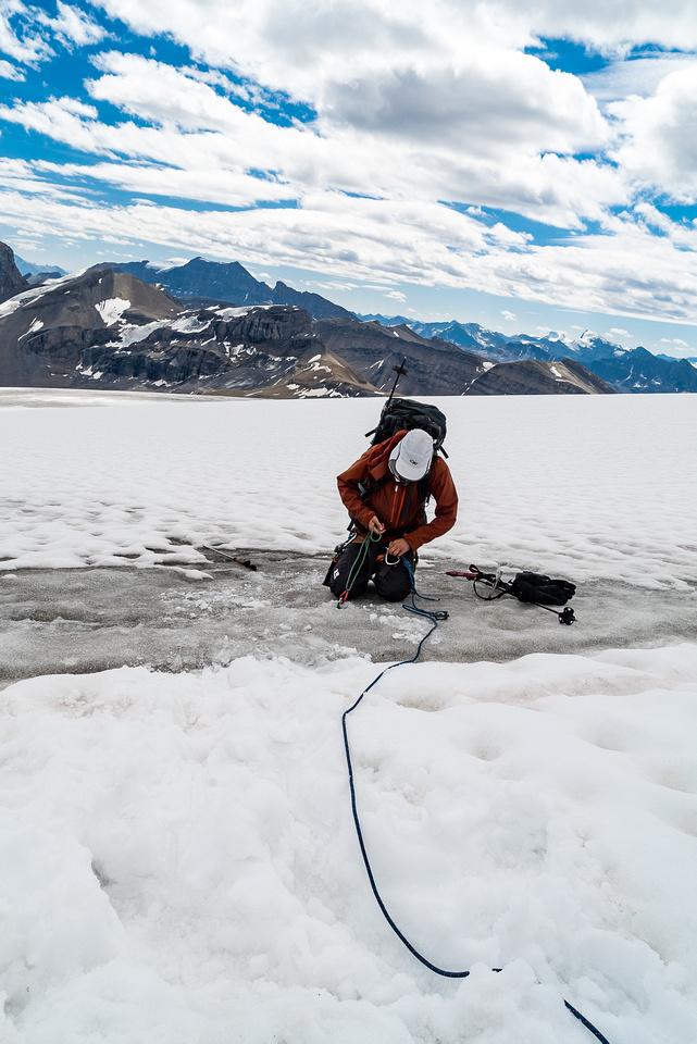 Setting up an ice screw belay for the sloppy bridge in front of me.