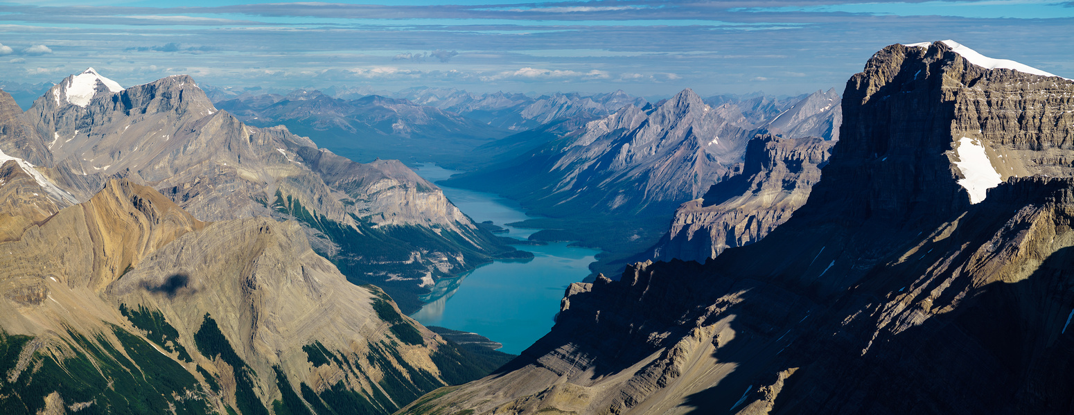 Incredible views down a very calm Maligne Lake with Unwin / Charlton on the L and Warren on the R.