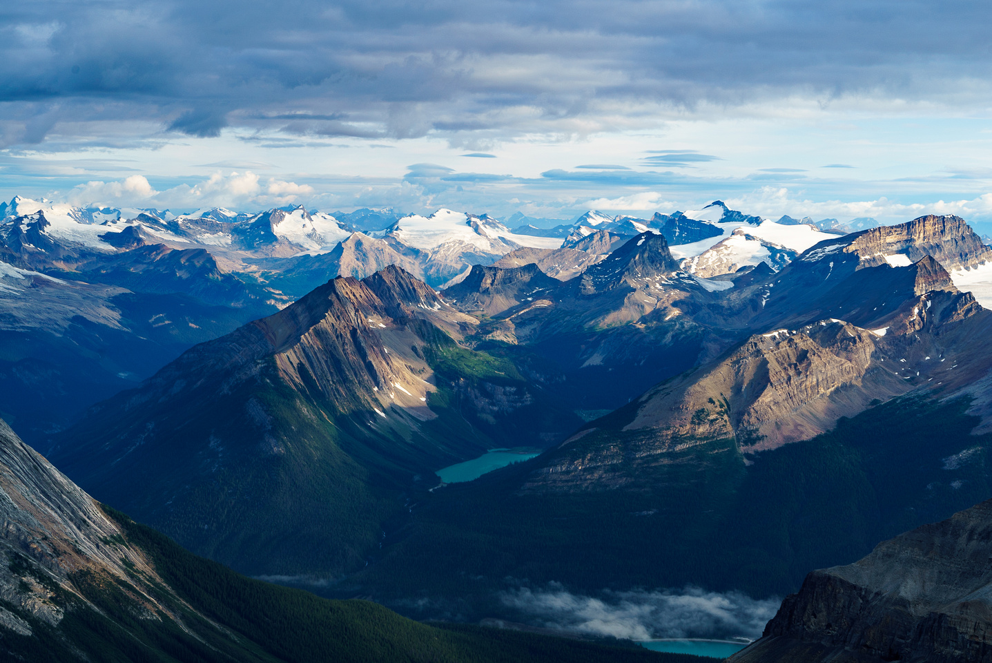 Summits include from L to R, Des Poilus, Yoho, Ogden, Collie, Niles, Balfour and Daly with many others less visible.