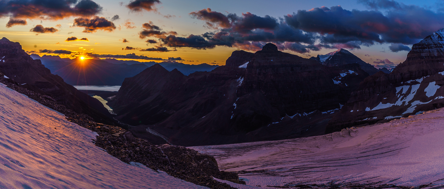 Now we're on the glacier as the sun peeks over the horizon and turns everything pink.