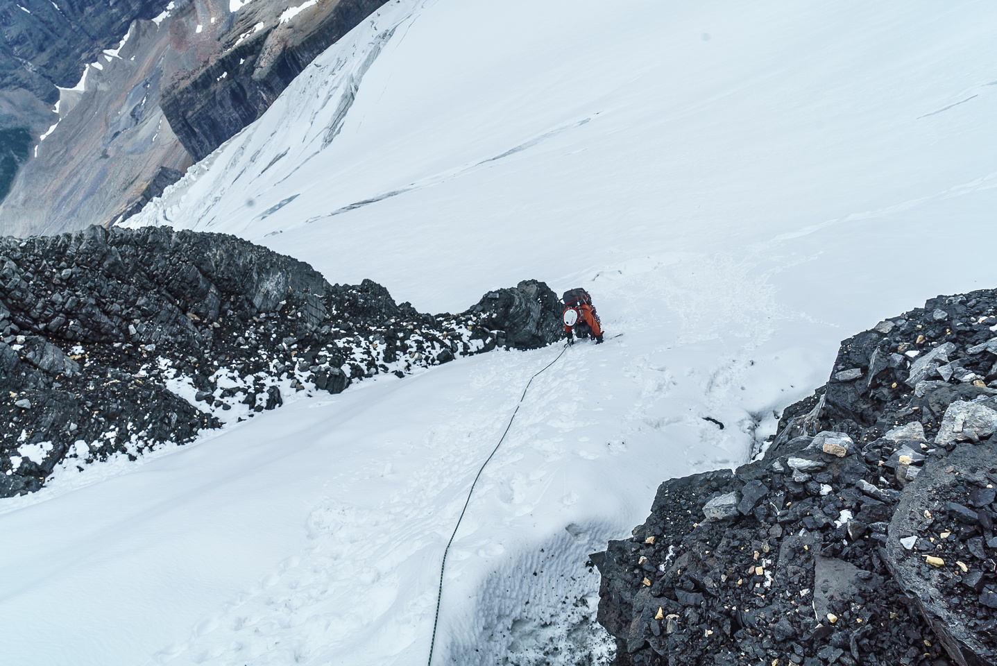 Down climbing the steep snow gully to the ,schrund.