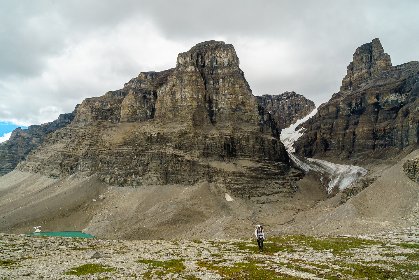 Steven crests the col with Hall Tower and it's glacier on the right and Englehard Tower in behind. East Tower in the foreground.