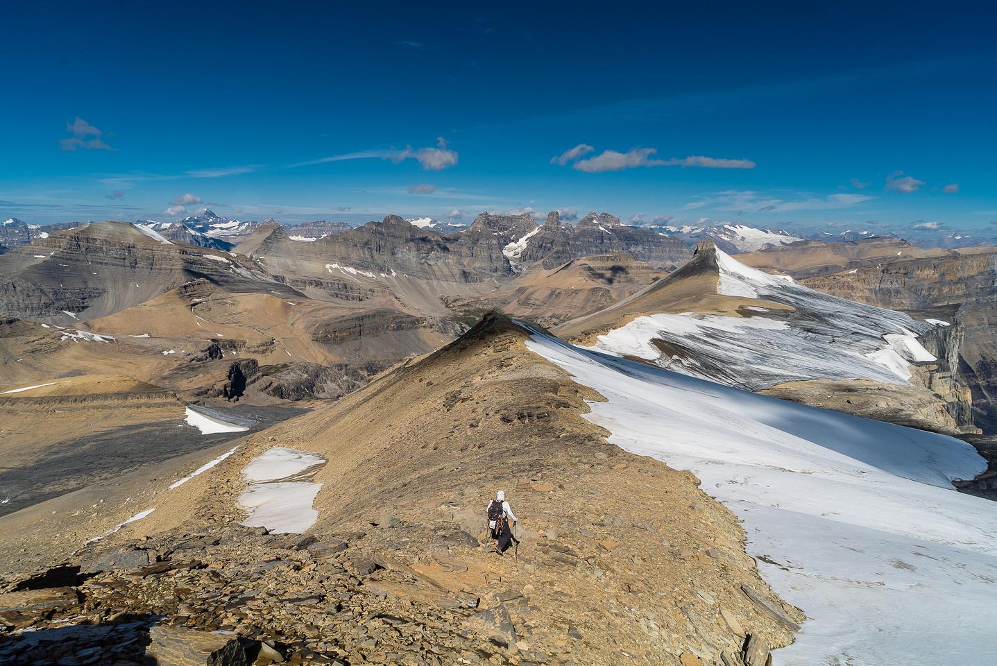 Steven heads down Marmota Peak.