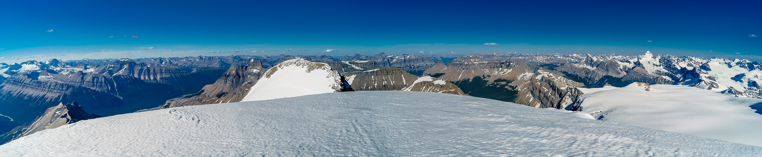 Looking east over Rudolph Peak - our next destination - with peaks from Saskatchewan to Amery to Forbes in the distance.