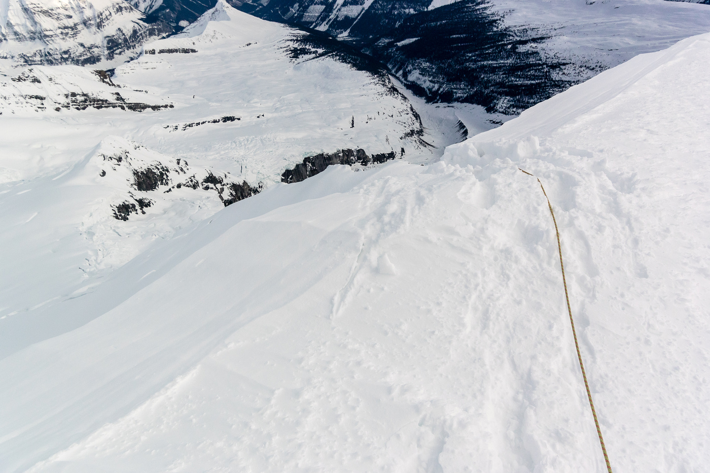 The rope disappears over the edge as I approach the lip of the upper east face.