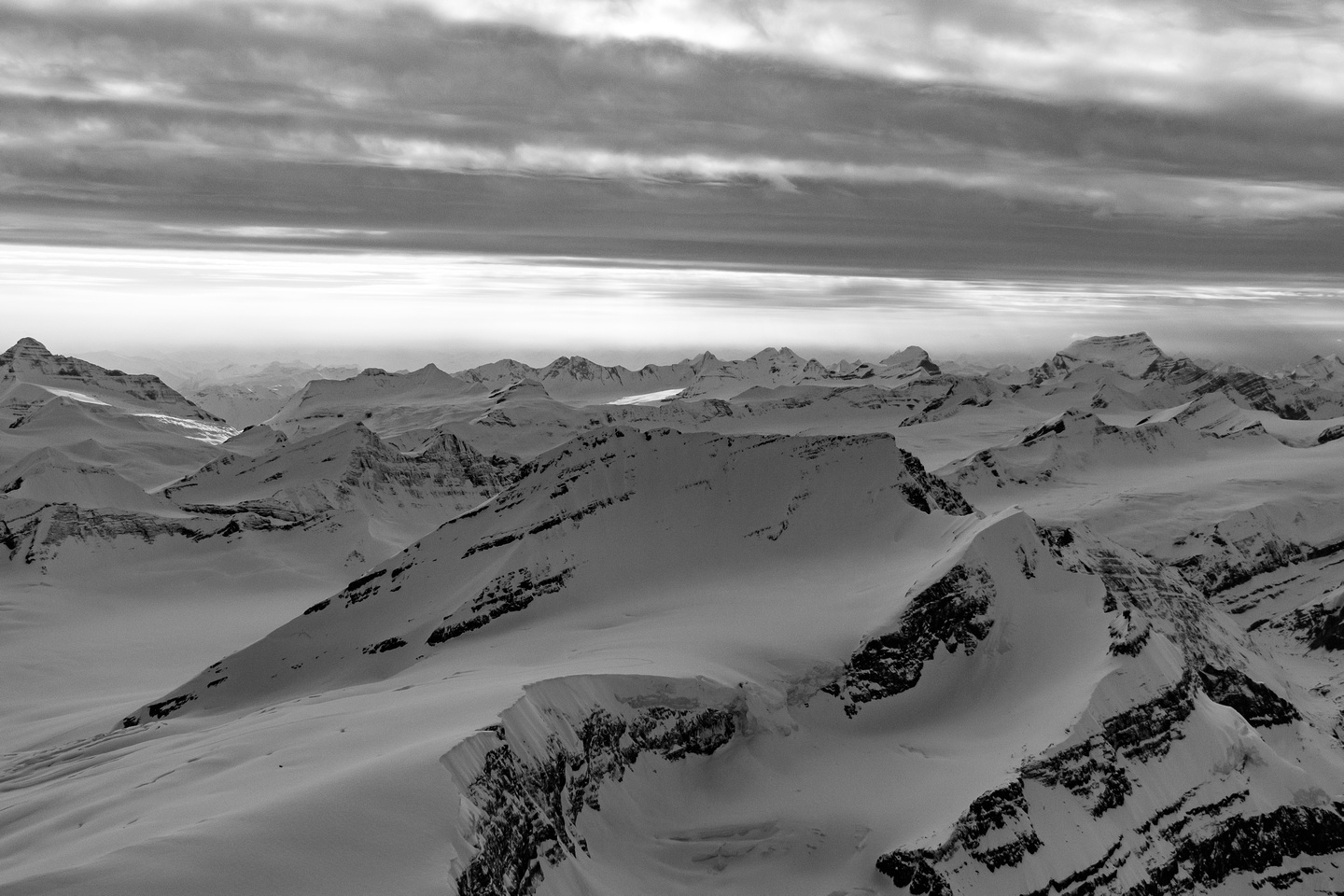 The long SW ridge of King Edward rises from the icefield to the summit at lower left to center with the east face at center