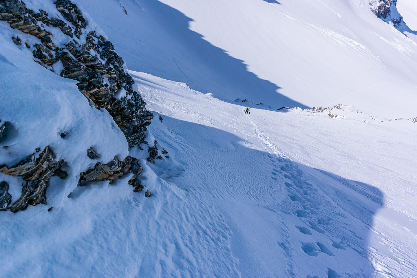 Looking back down at Ferenc after ditching the 'shoes and rocketing straight up the steep snow slope.