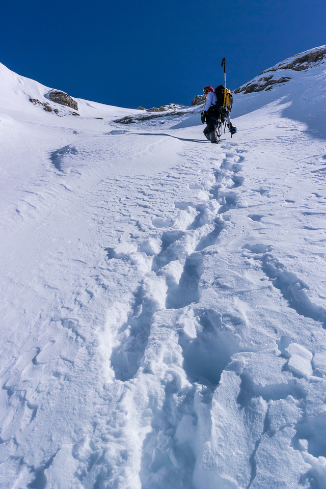 Ferenc continues to break trail for a while as we get higher up the west face beneath the AA col.