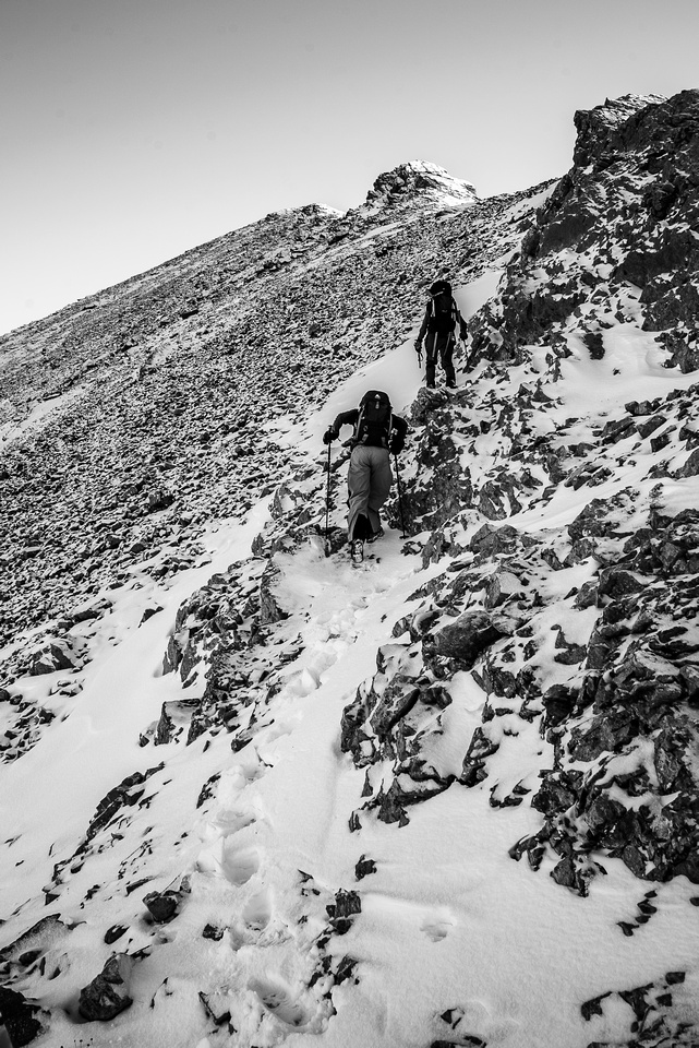 Avoiding slick slabs by traversing up on climbers left.
