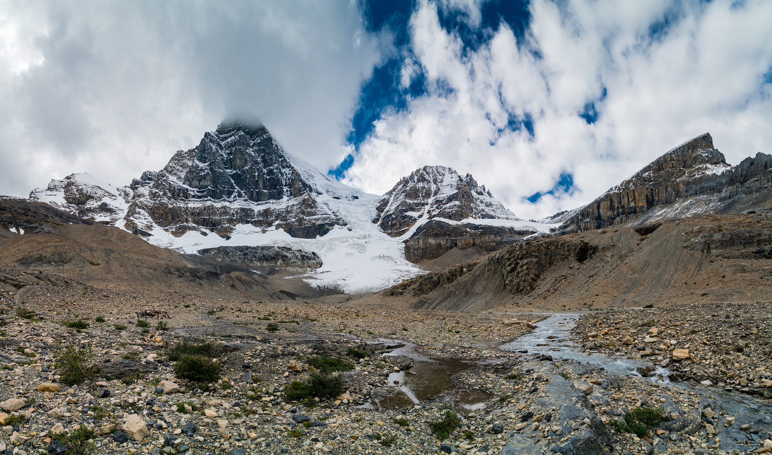 Just before the bivy site - views are stunning! There's quite a bit of fresh snow on our route but this means less ice in the couloirs, which is a good thing.