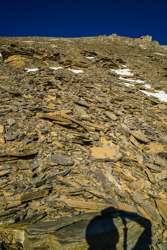 Looking up at the endless scree slog awaiting us.