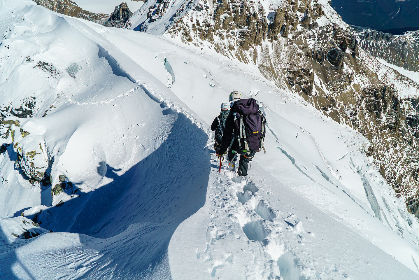 Shadows descending the snow arete.