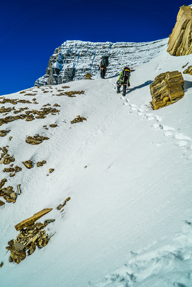 Steven and Ben traverse out of the second couloir - note the cairn.