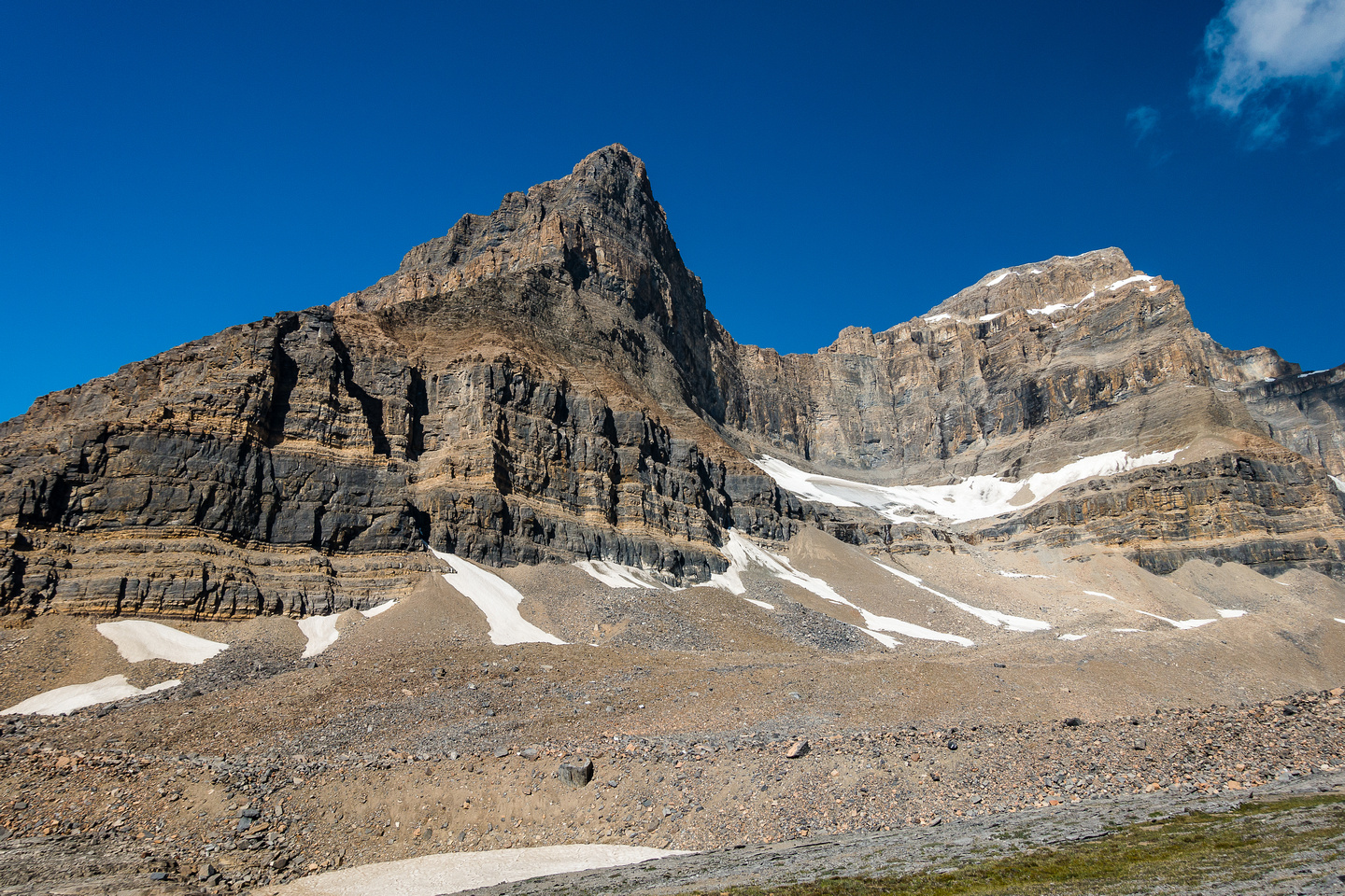 Looking up at Portal (L) and Thompson (R) from the plateau. Note the snow patches on the left. I ascended on climber's left of the leftmost patch