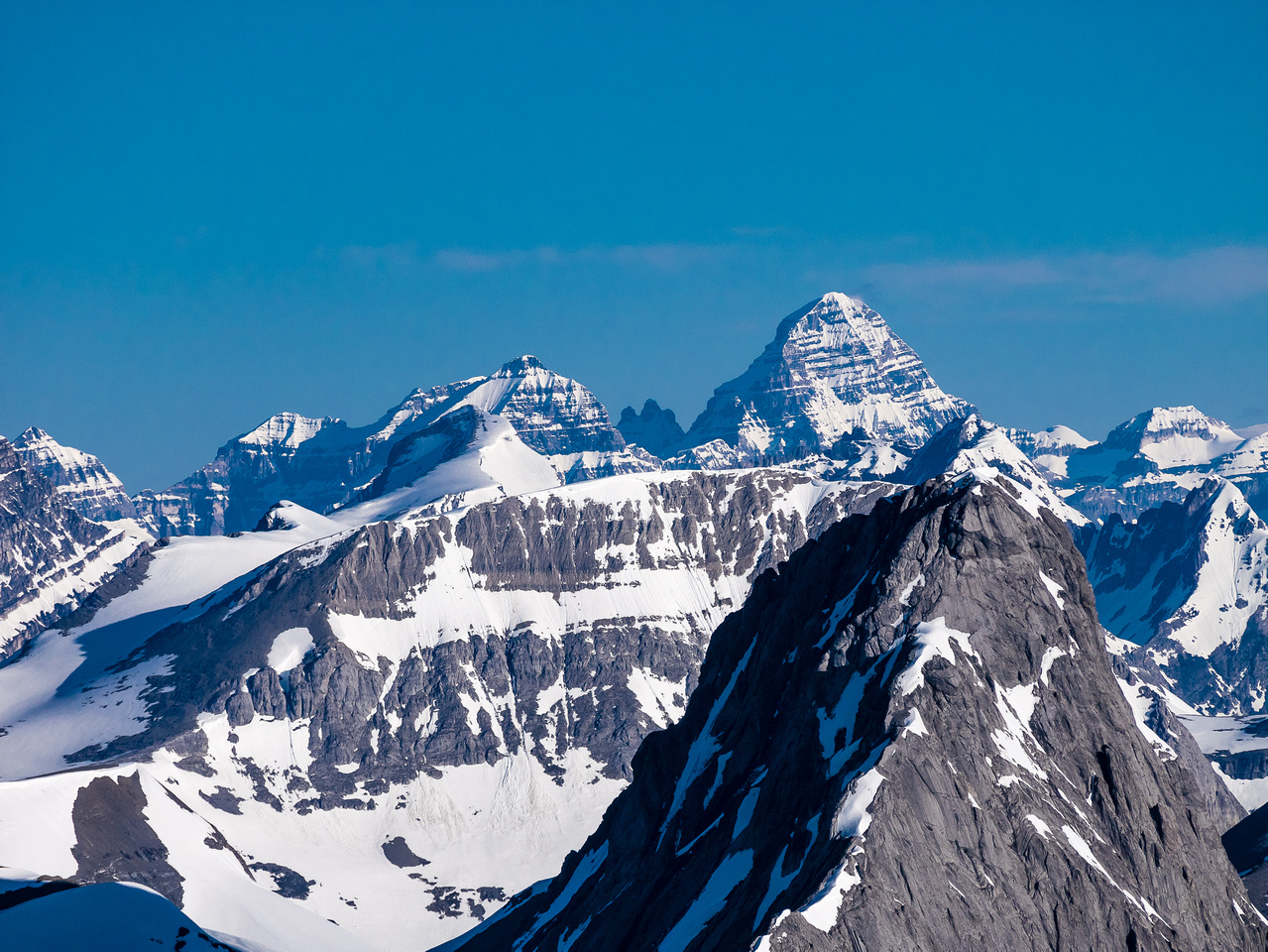 One of my favorite climbs - Assiniboine towers over one of my scariest ones - Northover!
