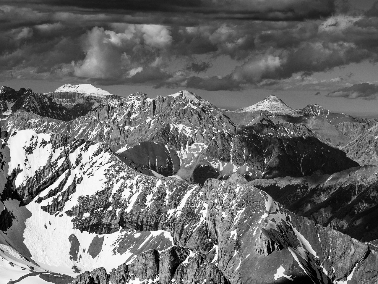 Part of the Banded Peak traverse with Cornwall, Outlaw and Banded from L to R in the distance rising over the Opal Range.